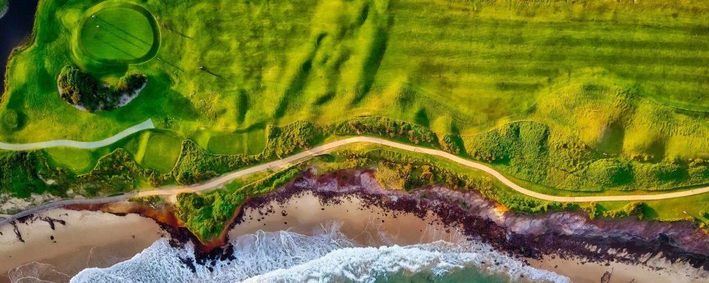 green grass field near body of water 1608383 1 2 - Making Golf Easier