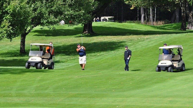 Golfers playing a round as a foursome