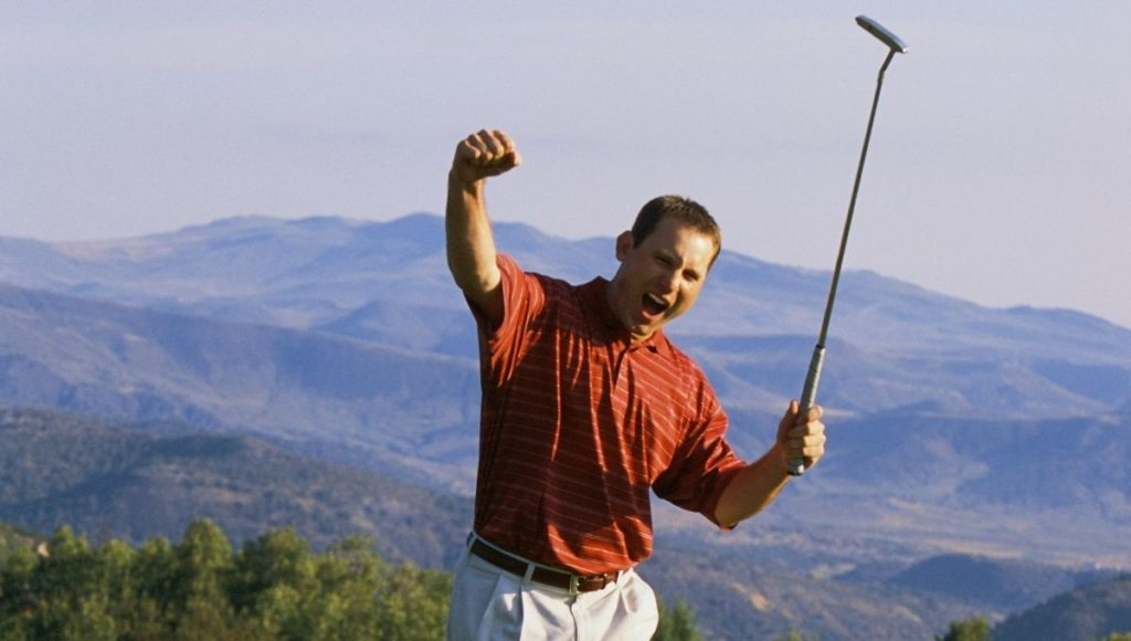 A man celebrating breaking 100 on a golf course