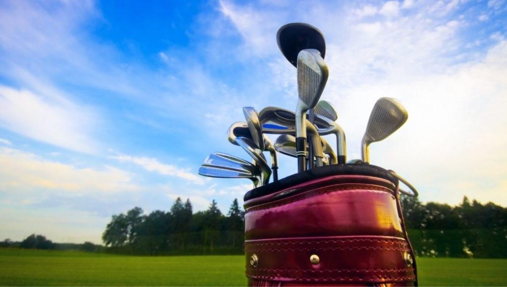 A selection of golf clubs in a bag