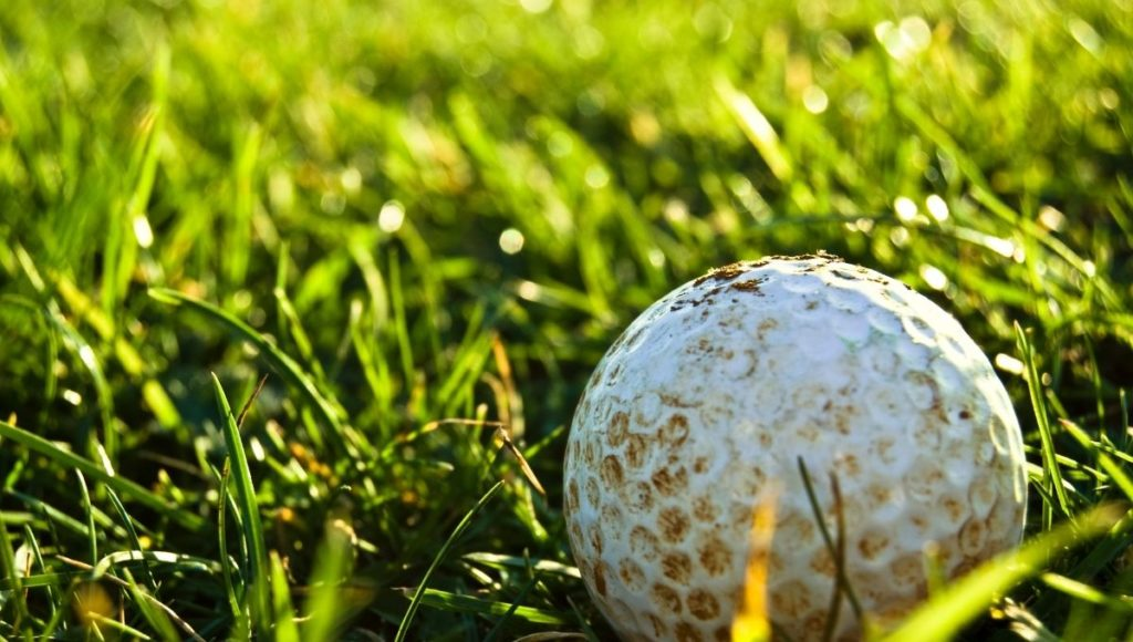 A dirty ball showing why it is important to know How to Clean a Golf Ball