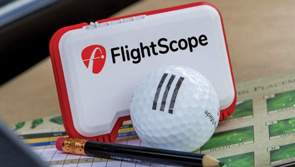 A small flightscope mevo mobile launch monitor with a golf ball