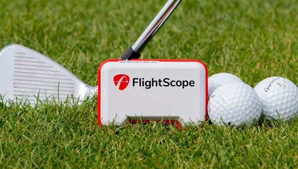 Flightscope mevo and some balls on green grass